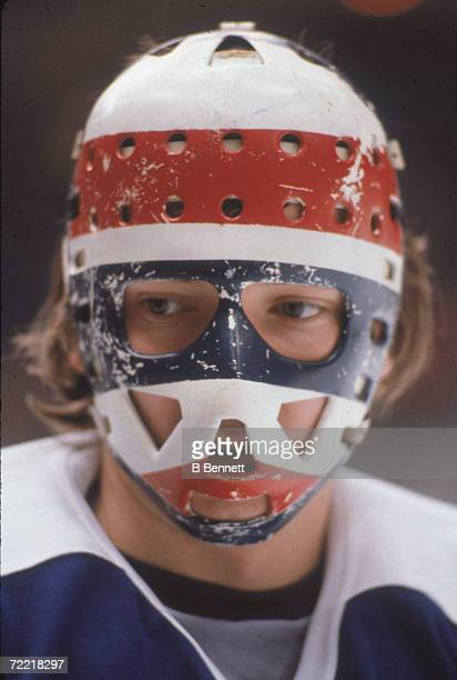 Headshot portrait of Czechoslovakian professional hockey player Jiri Crha goaltender for the Toronto Maple Leafs who wears a fiberglass goalie mask...