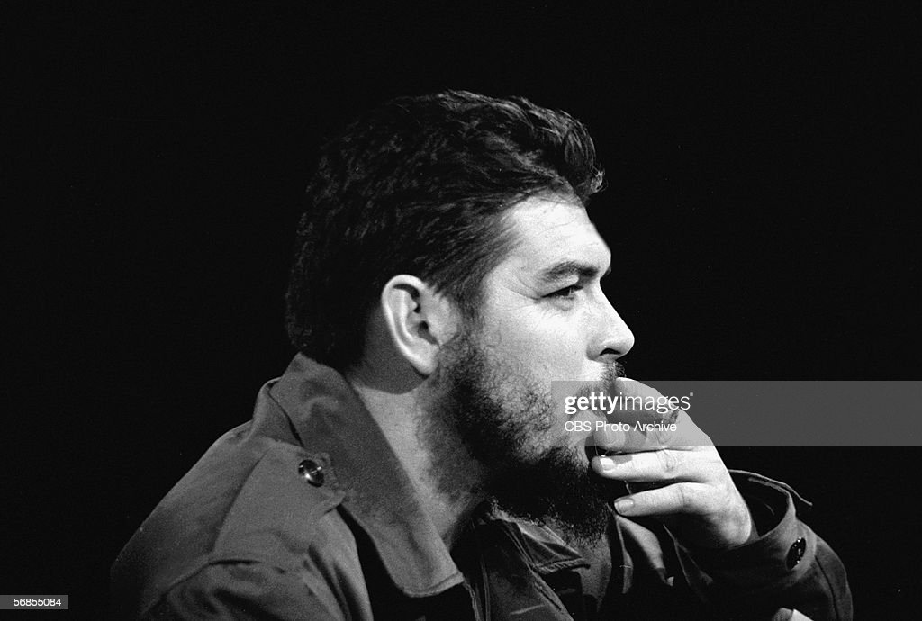 Headshot profile view of Argentinianborn Marxist revolutionary Ernesto Che Guevara Cuban Minister of Industry who is dressed in military fatigues and...