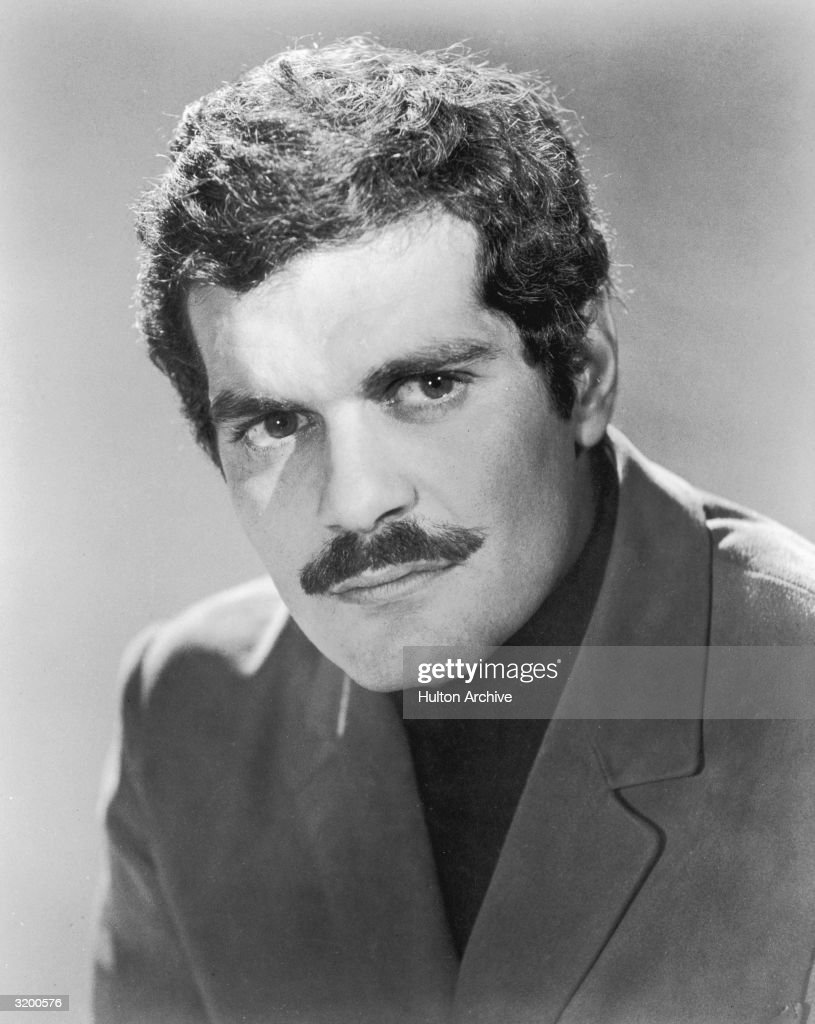 Headshot promotional portrait of Egyptian actor Omar Sharif as the Yugoslavian partisan in British director Anthony Asquith's film, 'The Yellow Rolls Royce'.