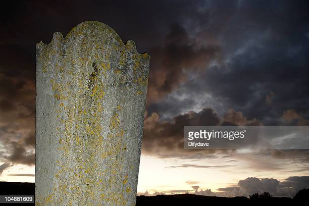 Headstone Against Moody Evening Sky