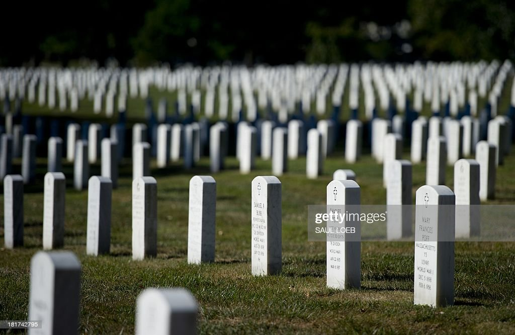 Headstones are seen marking graves at Arlington National Cemetery in Arlington, Virginia, September 24, 2013. More than 400,000 people are buried at the cemetery, which was founded during the American Civil War. AFP PHOTO / Saul LOEB
