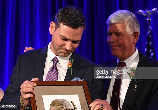 Headstrong Project Veteran Frank Lesnefsky accepts a Moral Courage award from General Mark Graham during Headstrong Project Words Of War Gala at Pier...