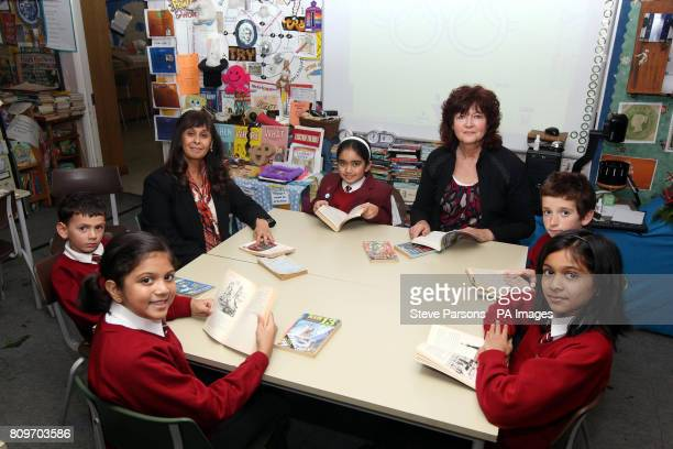 Headteacher Rekha Bhakoo CBE and teacher Gill Bland sit with pupils Aakanksha Benjamin Saasha Stanley and Jahnvi at Newton Farm Infant and Nursery...