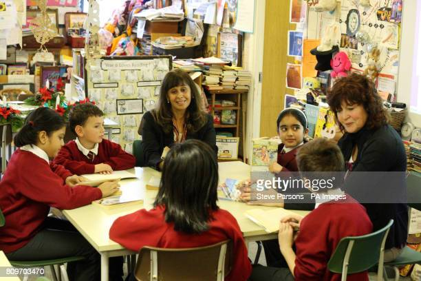 Headteacher Rekha Bhakoo CBE and teacher Gill Bland speak with pupils Aakanksha Benjamin Saasha Stanley and Jahnvi at Newton Farm Infant and Nursery...