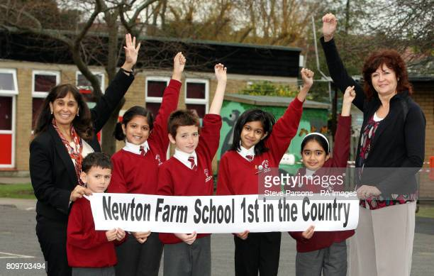 Headteacher Rekha Bhakoo CBE and teacher Gill Bland stand with pupils Benjamin Aakanksha Stanley Jahnvi and Saasha at Newton Farm Infant and Nursery...