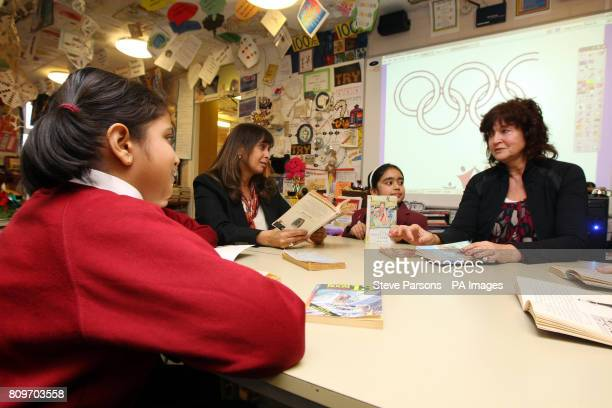 Headteacher Rekha Bhakoo CBE and teacher Gill Bland with pupils Aakanksha and Saasha at Newton Farm Infant and Nursery School in Harrow which gained...