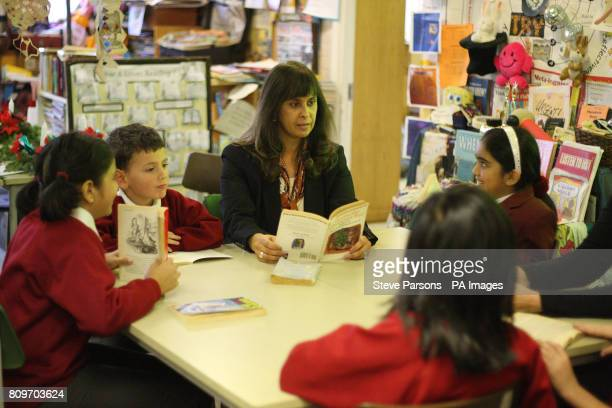 Headteacher Rekha Bhakoo CBE with pupils Aakanksha Benjamin Saasha and Jahnvi at Newton Farm Infant and Nursery School in Harrow which gained the...