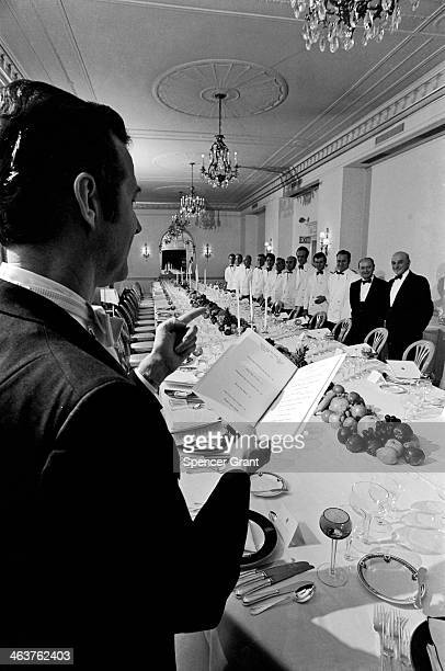 Headwaiter briefs servers before gourmet society dinner at RitzCarlton Hotel Boston Massachusetts 1972
