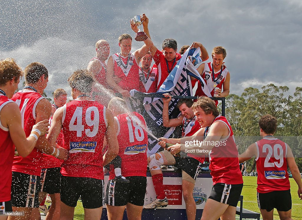 Healesville celebrate after being presented with the premiership flag and trophy after winning the Yarra Valley Mountain District Football League Division 2 Reserves Grand Final between Healesville and Seville at Yarra Junction Football Ground on September 14, 2013 in Melbourne, Australia.