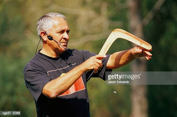 Healesville Sanctuary, Victoria, Australia. An Aboriginal guide teaching how to throw a boomerang.