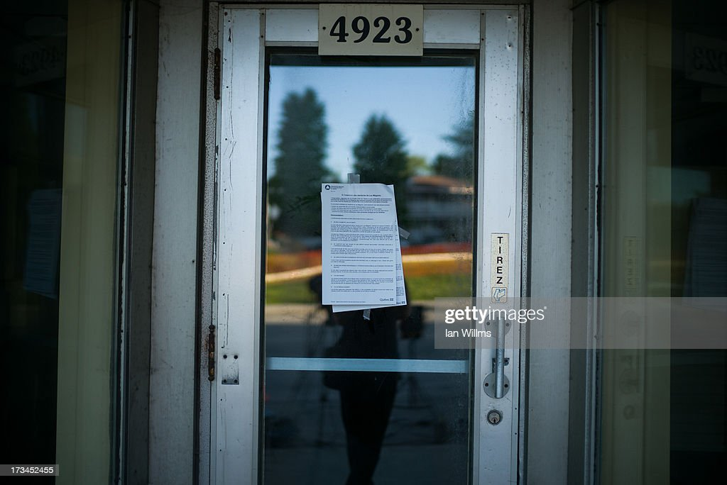 A health advisory is taped to the door of a storefront, just metres from the crash site on July 13, 2013 in Lac-Megantic, Quebec, Canada. A train derailed and exploded into a massive fire that flattened dozens of buildings in the town's historic district, leaving 60 people dead or missing in the early morning hours of July 6.