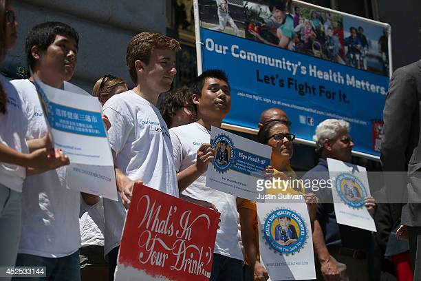 Health advocates hold signs during a rally in favor of a soda tax at San Francisco City Hall on July 22 2014 in San Francisco California The San...