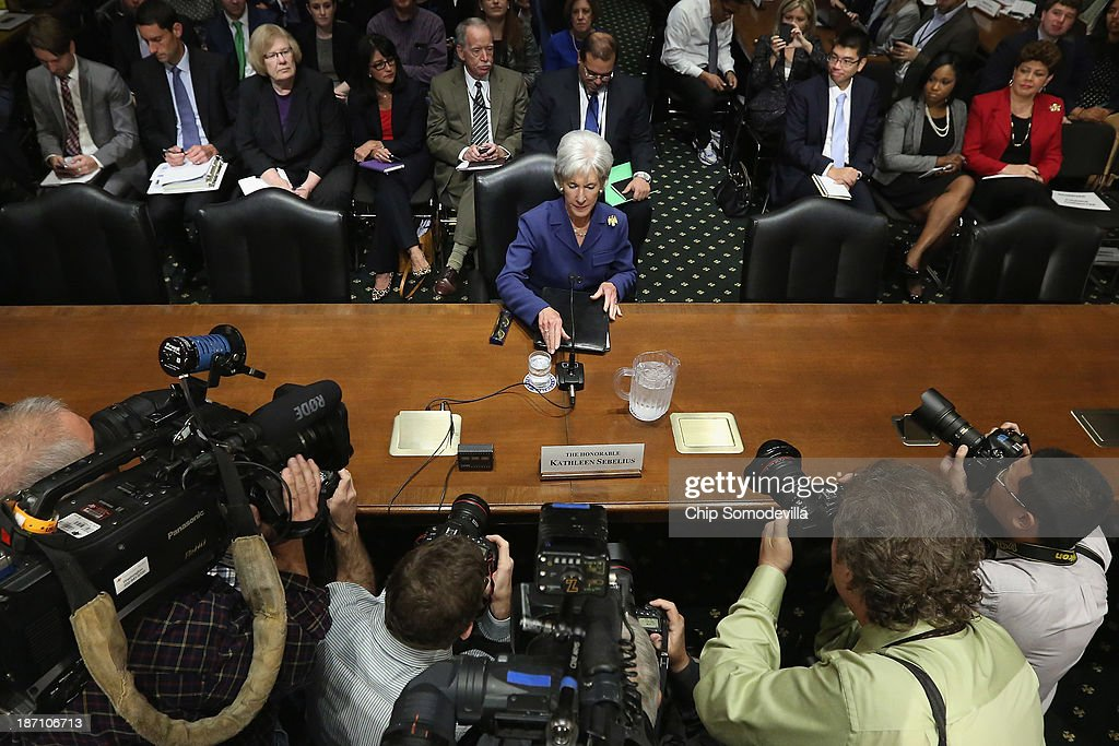 Health and Human Services Secretary <a gi-track='captionPersonalityLinkClicked' href=/galleries/search?phrase=Kathleen+Sebelius&family=editorial&specificpeople=700528 ng-click='$event.stopPropagation()'>Kathleen Sebelius</a> prepares to testify about the error-plagued launch of Healthcare.gov while testifying before the Senate Finance Committee in the Dirksen Senate Office Building on Capitol Hill November 6, 2013 in Washington, DC. Sebelius also faced tough questions from both Republicans and Democrats about people being kicked off their health insurance plans after President Barack Obama's earlier promise that if people liked their current coverage they could keep it under the Affordable Care Act.