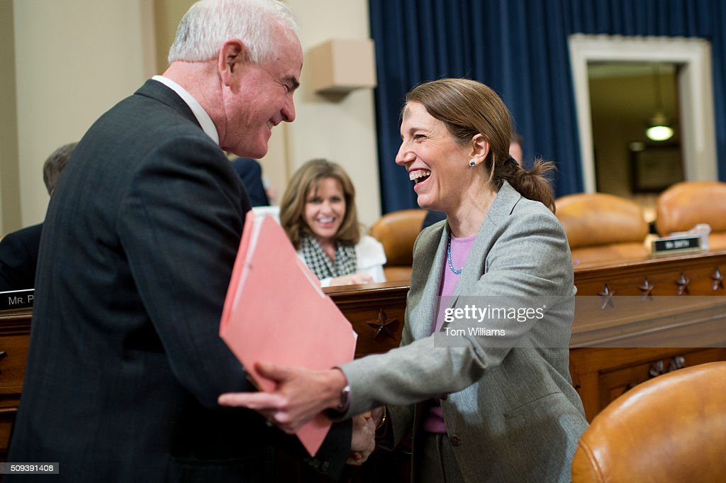 Health and Human Services Secretary Sylvia Mathews Burwell greets Rep. Patrick Meehan, R-Pa., before a House Ways and Means Committee hearing in Longworth on the HHS Fiscal Year 2017 budget request, February 10, 2016.