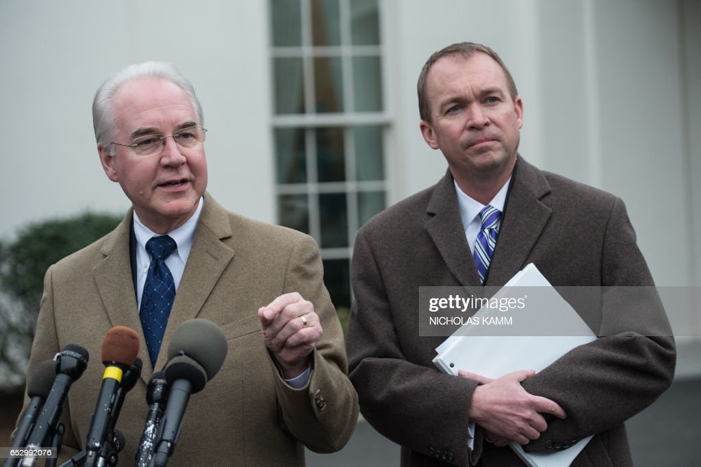 US Health and Human Services Secretary Tom Price speaks to reporters with Office of Management and Budget Director Mick Mulvaney outside the West Wing of the White House in Washington, DC, on March 13, 2017. /