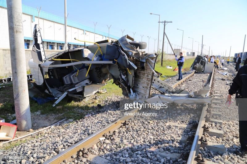 Health and police officers examine the scene after the accident in Mersin, Turkey on March 20, 2014. Passenger train crash service vehicle which carries workers, nine people were dead in an accident, Mersin, Turkey on March 20, 2014.