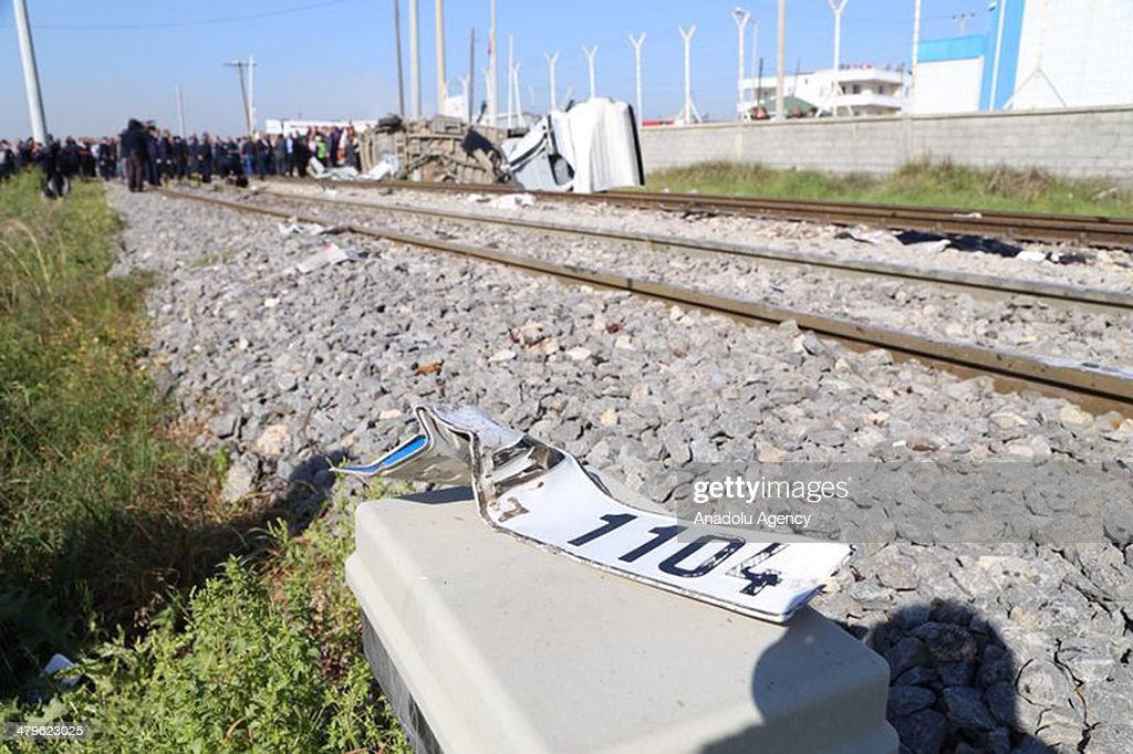 Health and police officers examine the scene after the accident in Mersin, Turkey on March 20, 2014. Passenger train crashed into a service vehicle that was carrying personnel to work, killing nine people. The accident happened at a level crossing near the Mediterranean port city of Mersin.