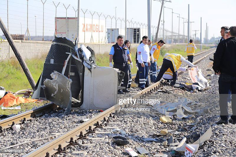 Health and police officers examines the scene after the accident in Mersin, Turkey on March 20, 2014. Passenger train crash service vehicle which carries workers, nine people were dead in an accident, Mersin, Turkey on March 20, 2014.