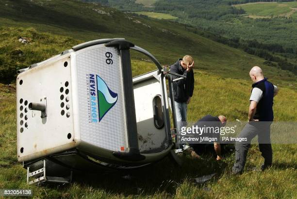 Health and Safety Executive and police officers with Nevis Range staff inspect the grip from the fallen gondola which yesterday plunged onto a...