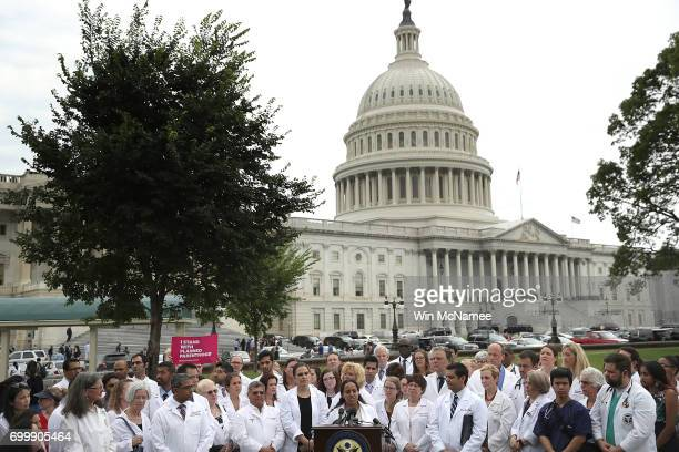 Health care providers hold a news conference outside the US Capitol June 22 2017 in Washington DC House Democratic Leader Nancy Pelosi and fellow...