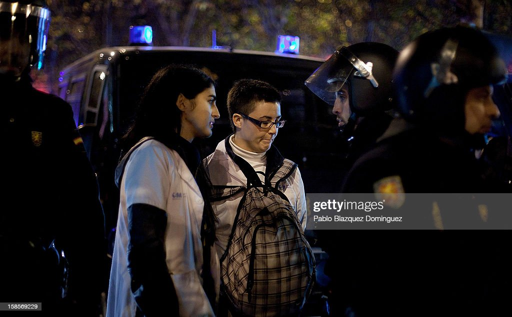 Health care workers are questioned by riot police during a demonstration outside Madrid Regional Asembly on December 19, 2012 in Madrid, Spain. As of today, health workers unions are calling for a third 48-hour strike against cuts on public health care and the privatization of medical centers and hospitals.