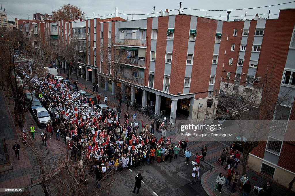 Health care workers rally at a demonstration towards Madrid Regional Asembly on December 19, 2012 in Madrid, Spain. As of today, health workers unions are calling for a third 48-hour strike against cuts on public health care and the privatization of medical centers and hospitals.