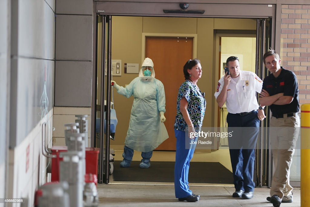 Health care workers wait for the arrival of a possible Ebola patient at the Texas Health Presbyterian Hospital on October 8 2014 in Dallas Texas...