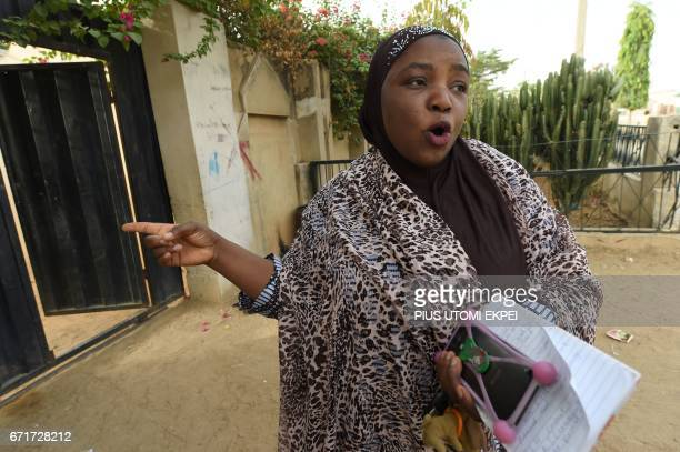 UNICEF health consultant Hadiza Waya points to a house where health workers were resisted during a vaccination campaign against polio at HotoroKudu...