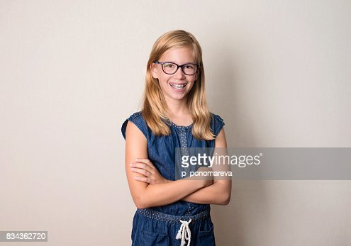 Health, education and people concept. Happy teen girl in braces and eyeglasses isolated. : Stock Photo