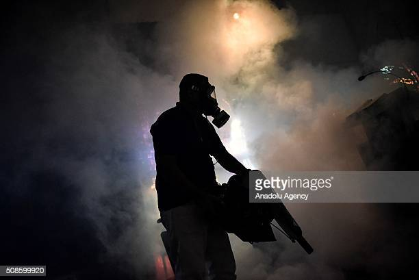 Health employee fumigates against Aedes Aegypti mosquito at a church in Caracas on February 5 2016 Venezuela has recorded 4700 suspected cases of...