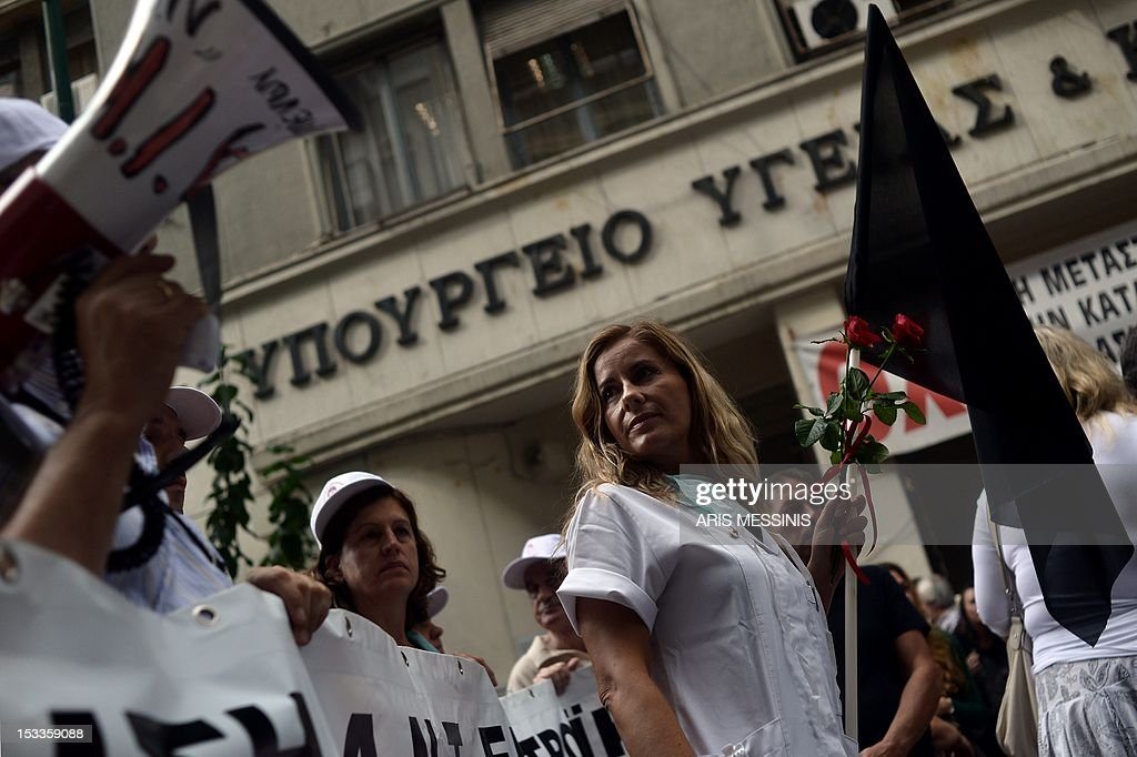 Health employees demonstrate outside the Health Ministry in Athens on October 4 2012 against pay and budget cuts planned in the latest round of...