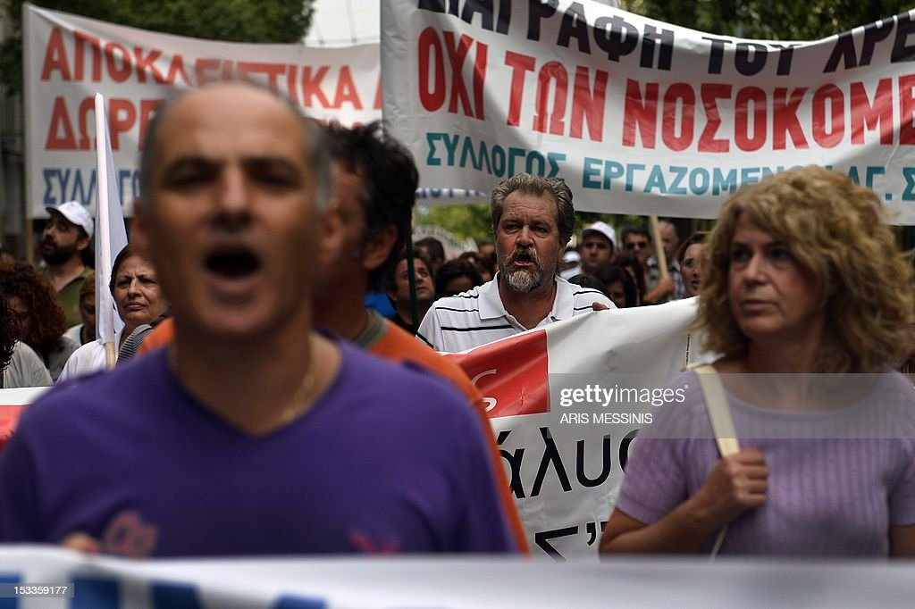 Health employees protest outside the Health Ministry in Athens on October 4 2012 against pay and budget cuts planned in the latest round of austerity...