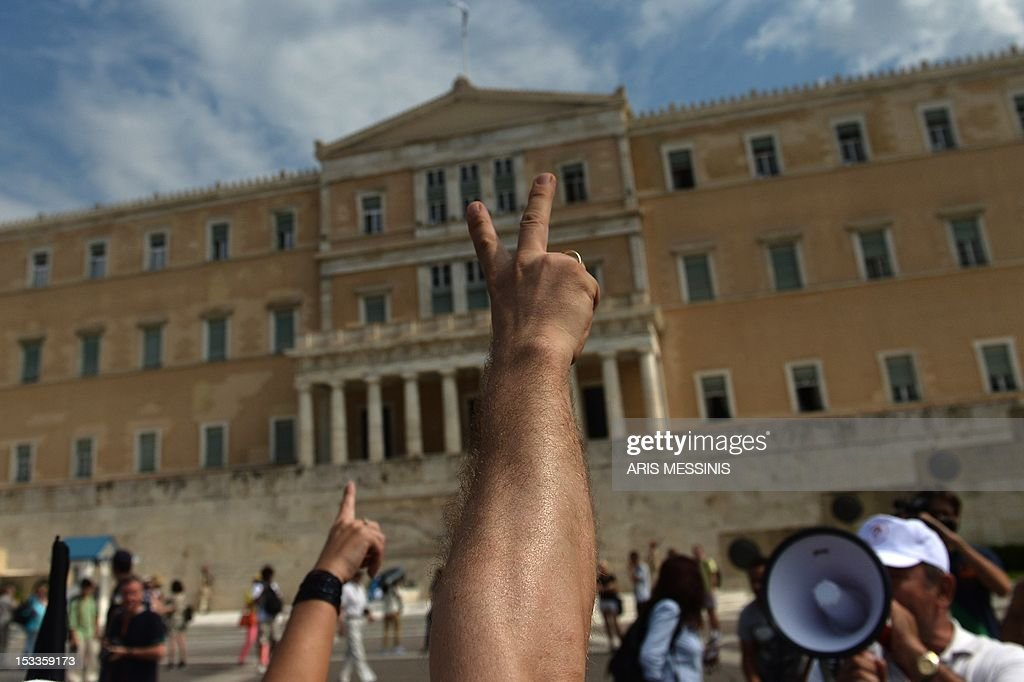 Health employees protest outside the parliament in Athens on October 4 2012 against pay and budget cuts planned in the latest round of austerity...
