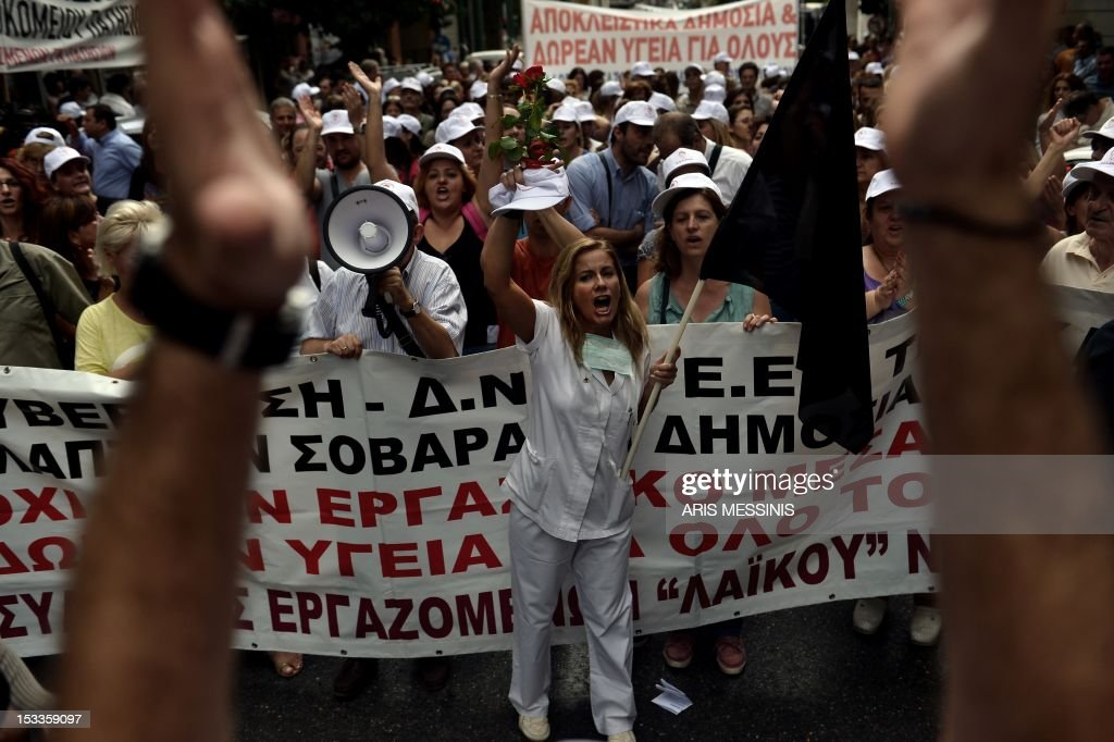 Health employees shout slogans outside the Health Ministry in Athens on October 4 2012 against pay and budget cuts planned in the latest round of...