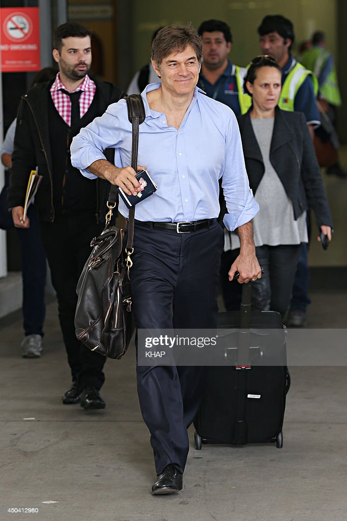 U.S. health guru, Dr Mehmet Oz arrives with his family at Sydney International Airport on June 11, 2014 in Sydney, Australia.