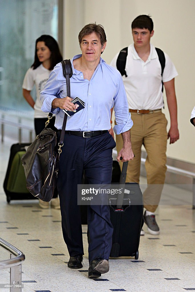 U.S. health guru, Dr <a gi-track='captionPersonalityLinkClicked' href=/galleries/search?phrase=Mehmet+Oz&family=editorial&specificpeople=4175862 ng-click='$event.stopPropagation()'>Mehmet Oz</a> arrives with his family at Sydney International Airport on June 11, 2014 in Sydney, Australia.