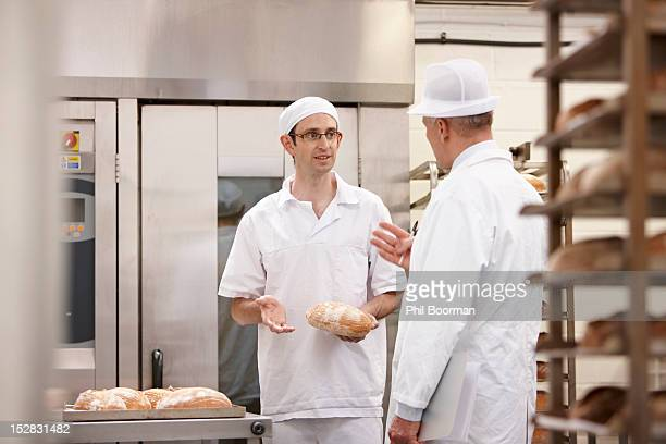 Health inspector with chef in kitchen