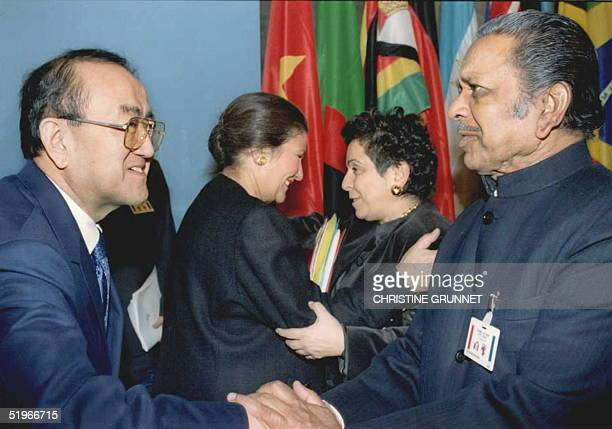 Health minister Donna E Shalala greets her French counterpart Simone Weil as World Health Organization Director General Dr Hiroshi Nakajima shakes...
