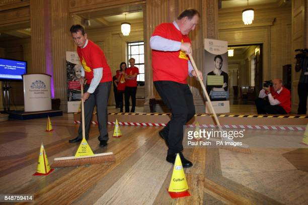 Health Minister Edwin Poots competes with Pat Ramsey MLA to control marbles with a brushto Highlight World mental health day