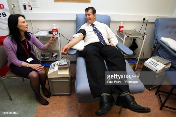 Health Minister Edwin Poots gives blood at Northern Ireland's Blood Transfusion Service headquarters Belfast City Hospital ahead of World Blood Donor...