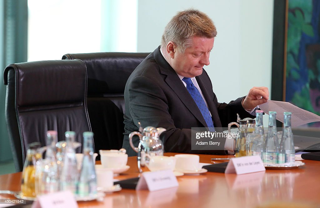 Health Minister <a gi-track='captionPersonalityLinkClicked' href=/galleries/search?phrase=Hermann+Groehe&family=editorial&specificpeople=6400355 ng-click='$event.stopPropagation()'>Hermann Groehe</a> (CDU) arrives for the weekly German federal Cabinet meeting on June 11, 2014 in Berlin, Germany. High on the meeting's agenda was discussion over the country's arms export policies.