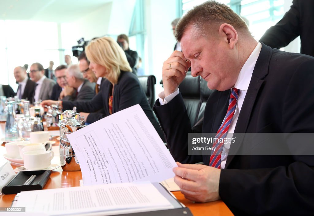 Health Minister <a gi-track='captionPersonalityLinkClicked' href=/galleries/search?phrase=Hermann+Groehe&family=editorial&specificpeople=6400355 ng-click='$event.stopPropagation()'>Hermann Groehe</a> (CDU) arrives for the weekly German federal government Cabinet meeting on March 26, 2014 in Berlin, Germany. High on the meeting's agenda was discussion of improvements in the quality of the finance structure of the country's health insurance system.