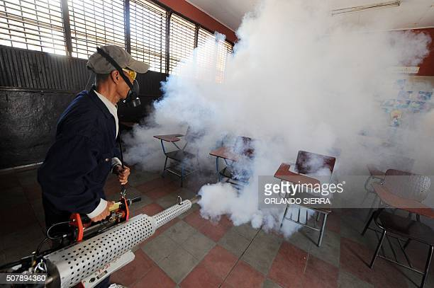 Health ministry personnel fumigate against the Aedes aegypti mosquito vector of the dengue Chikungunya and Zika viruses in Tegucigalpa on February 1...