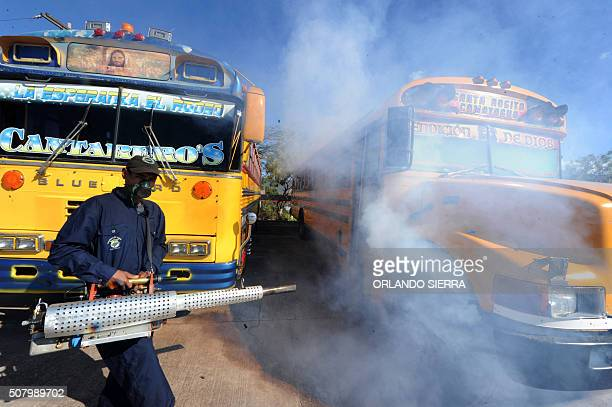 Health ministry personnel fumigate urban buses against the Aedes aegypti mosquito vector of the dengue Chikungunya and Zika viruses in Tegucigalpa on...