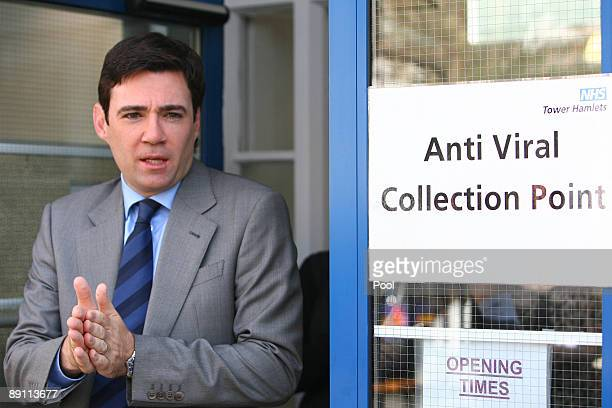 Health Secretary Andy Burnham rubs disinfectant gel onto his hands after visiting an antiviral clinic in Tower Hamlets on July 20 2009 in London...