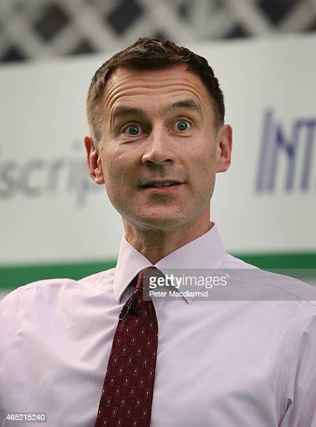 Health Secretary Jeremy Hunt holds up a memory stick containing a record of a whole human genome as he speaks at the UK eHealth Week event at Olympia...