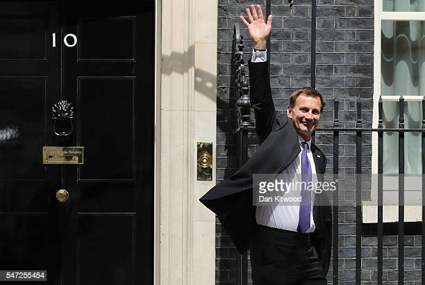 Health Secretary Jeremy Hunt waves as he leaves Downing Street as Prime Minister Theresa May appoints her cabinet on July 14 2016 in London England...