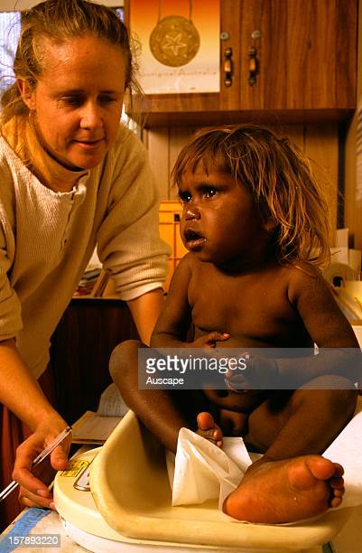 Health service workerassessing a childEngawala Aboriginal Community Northern Territory Australia