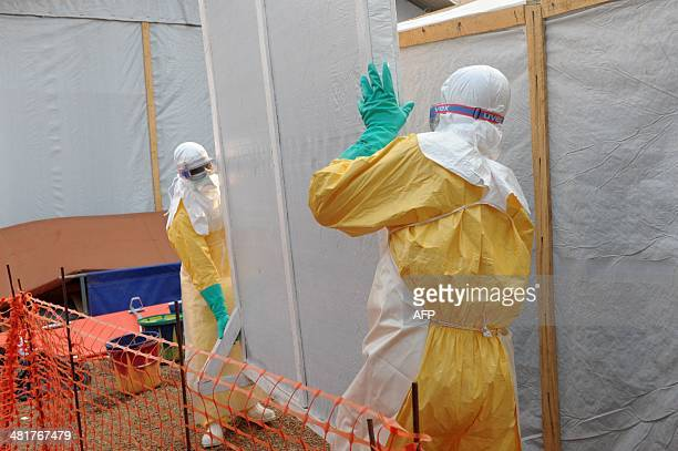 Health specialists work at an isolation ward for patients at the Doctors Without Borders facility in Guékedou southern Guinea Guinea's President...