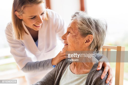 Health visitor and a senior woman during home visit. : Stock Photo